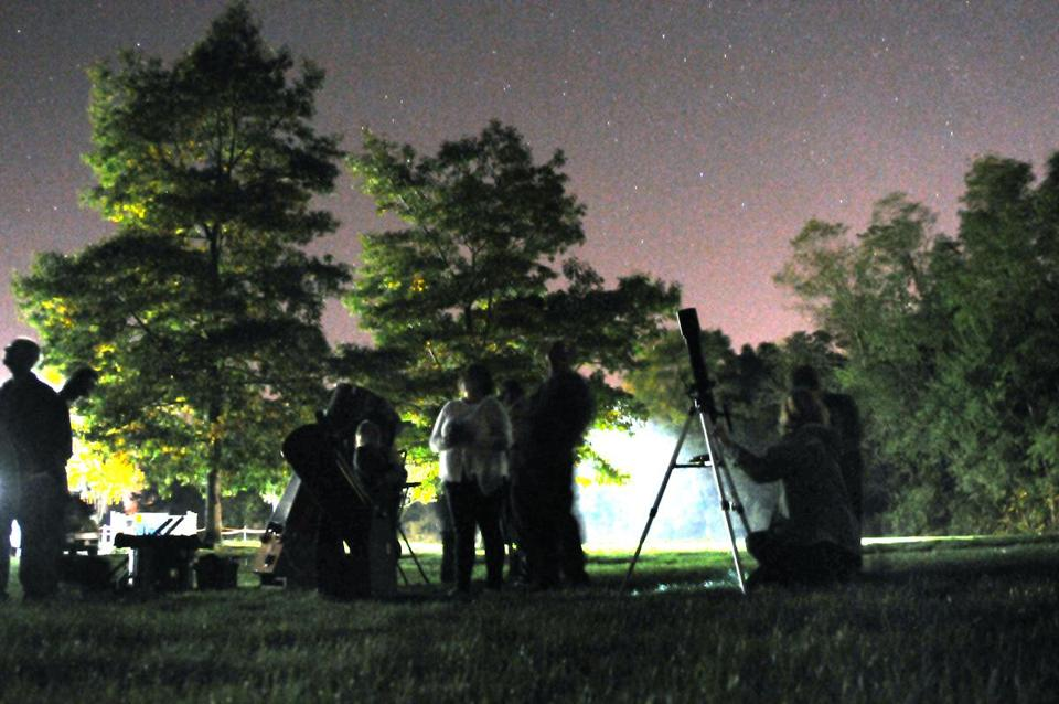 Members of the South Shore Astronomical Society gathered outside the Scituate Public Library this fall to view the night sky.